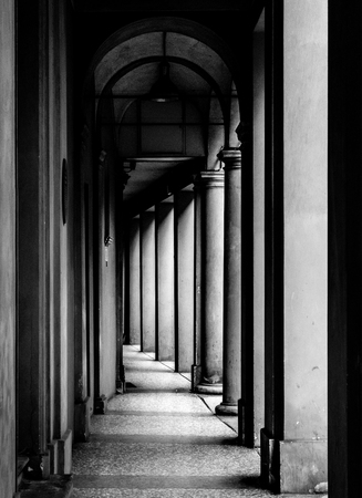 Portico, sheltered walkway, in Bologna with its almost 40 kilometres of porticos. Bologna is a unique city in the world. Redakční