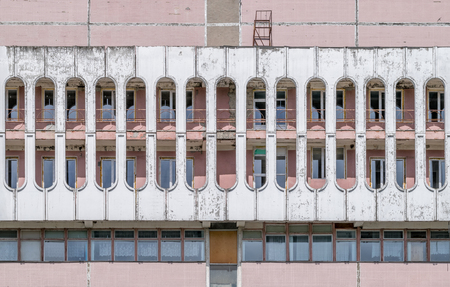 Cylinder shapes of a soviet era building in red& white brick. Stock Photo
