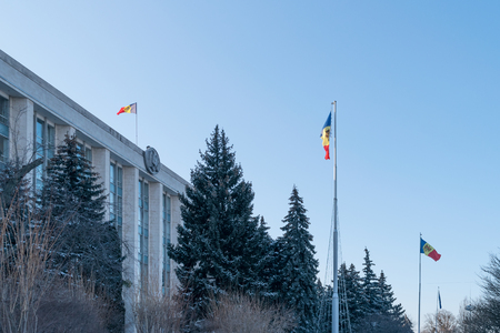 The national moldovan flag being flown nearby the Government of the Republic of Moldova.