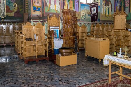 TRANSYLVANIA REGION, ROMANIA - JULY 2, 2017: An interior of a orthodox church, ready for a christening ceremony. 新聞圖片