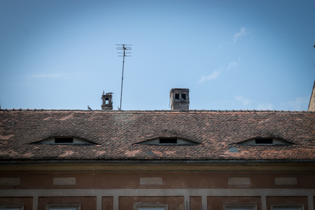 The roof eyes of a red building in Sibiu.