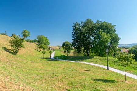 Beautiful park on a sunny day inside Alba-Iulia Citadel, Romania. 스톡 콘텐츠