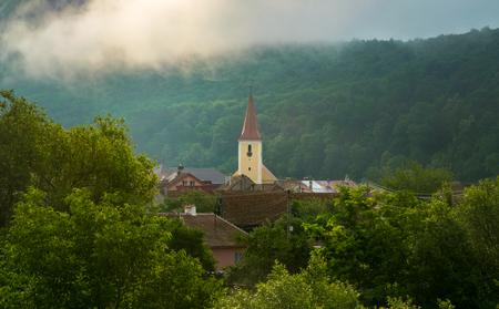 A church in a small village in Transylvania region, Romania. 스톡 콘텐츠