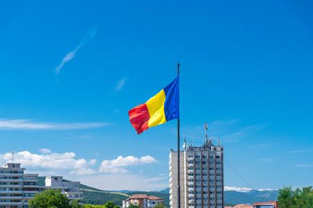 Romanian flag waving on a sunny summer day in Alba Iulia, Romania. Foto de archivo