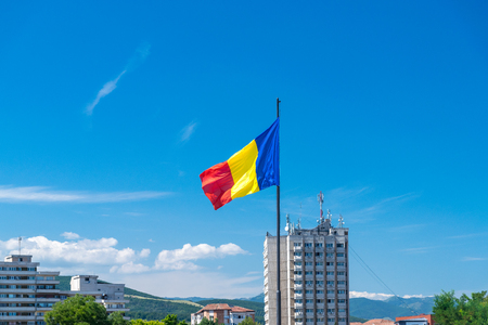 Romanian flag waving on a sunny summer day in Alba Iulia, Romania. 免版税图像