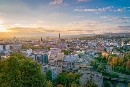 Cluj city overview at sunrise from Cetatuia Hill in Cluj-Napoca, Romania.