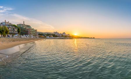 Sun rising at sunrise on a beautiful beach in Sunny Beach on the Black Sea coast of Bulgaria.