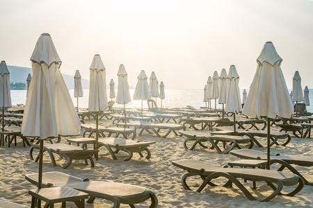 Chairs and umbrellas on a beautiful beach at sunrise in Sunny Beach on the Black Sea coast of Bulgaria.