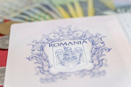 Romanian concept. The Romanian passport and Romanian banknotes/coins on a blue and red background. Coloseup of Romanian Passport and Romanian currency. Romania Finance and economy concept.