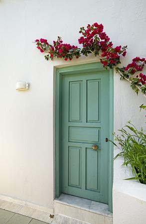 green door: green door in a white wall Stock Photo