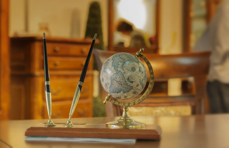gift set pen and globe stands on a wooden table in the room