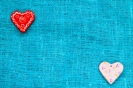 two heart on a turquoise background St. Valentines Day