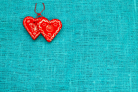 two red heart on a turquoise background St. Valentines Day