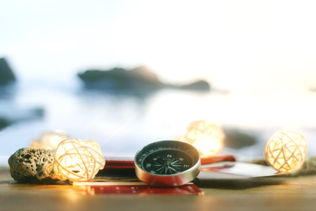 Time to Travel. Idea for tourism with passport, tickets and compass with garlands on the background of the sea. Concept on the theme of flights