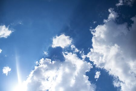 Blue sky background with clouds and sunlight. Banco de Imagens - 124730775