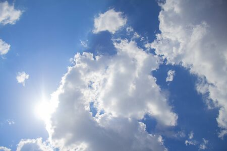 Blue sky background with clouds and sunlight Banco de Imagens