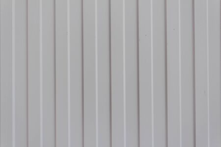 The texture of metal profiled, sheet material for fencing and roofing