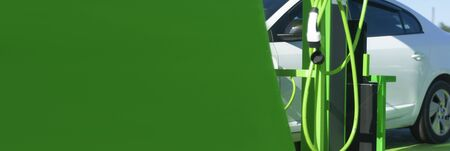 Electric car battery charging on charge station. Eco-friendly new generation gas station.