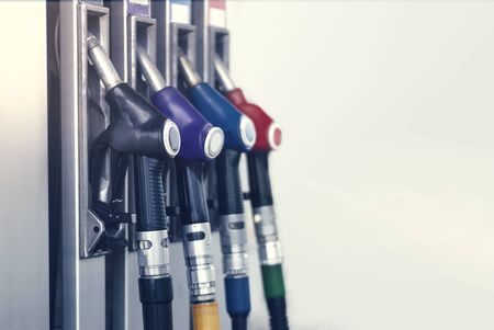 Gas station close-up with colored fuel hoses Reklamní fotografie