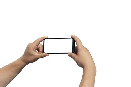 Man hand on white background holds phone with isolated screen. Mockup Technology