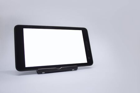 Mock up tablet with white display on a light background