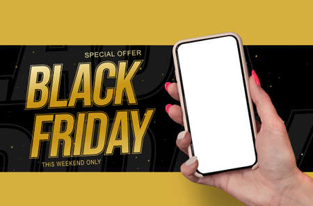 Woman Hand holding the black Mockup smartphone with beautiful nails on the background Black Friday. Mobile device isolated on blue colour 免版税图像
