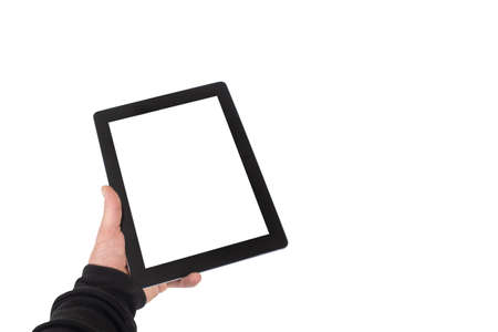 Mock-up technology . The guy is holding a tablet with a white screen on a light background 免版税图像