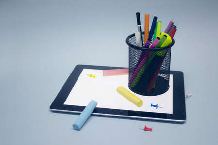 Back to school. Mock up tablet with drawing tools and other stationery on the background