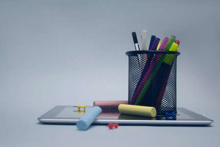 Back to school. Tablet with drawing tools and other stationery on the background 免版税图像