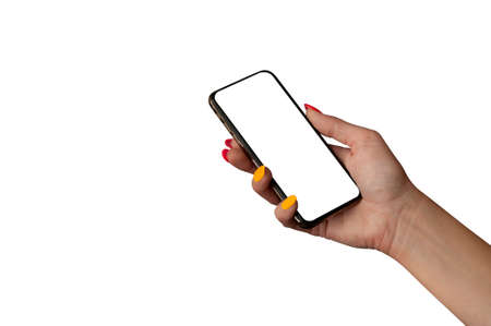 Woman Hand holding the black Mockup smartphone with isolated screen and beautiful nails. Mock-up Technology 免版税图像