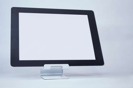 Mock up tablet with white display on a light background. Banco de Imagens