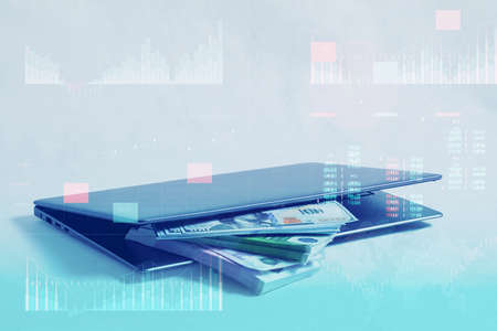 Business analytics with key performance indicators dashboard concept. Online work and investment concept. Laptop with a bundle of dollar and euro bills on a white background
