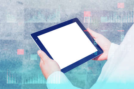 Business analytics (BA) with key performance indicators (KPI) dashboard concept. Tablet mockup with white screen. Businessman works at the computer