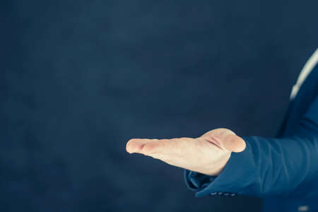 Businessman in a shirt and a blue jacket shows gestures with his hands