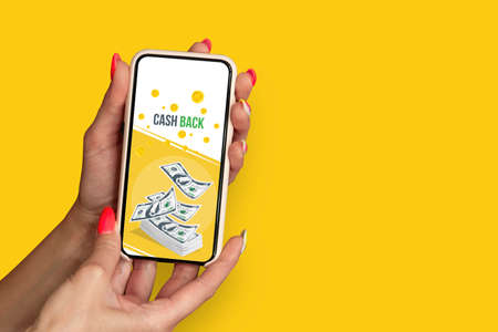 Girl with beautiful nails holds smartphone with banner Cash Back