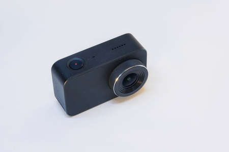 Compact action camera for shooting videos and photos on a white background