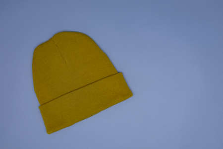 Mockup of an orange warm hat on a gray background