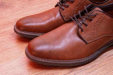 Men's classic pair of brown leather shoes Imagens