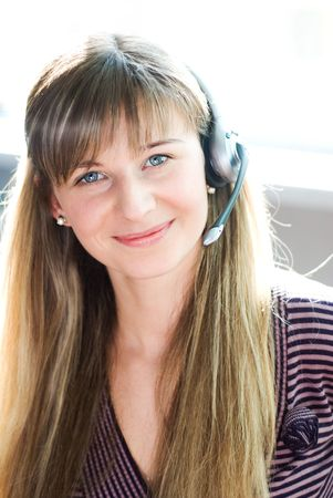 A contact center lady with a warm welcoming smile on her lovely face