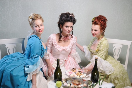 lavish: Three beautiful ladies in lavish dresses in a historical setting Stock Photo