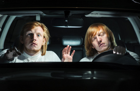 imminent: Man falling asleep behind the steering wheel, while his  twin is terrified, trying to warn him of an imminent collision