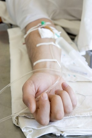 close up of a patients hand with intravenous injection Stock Photo