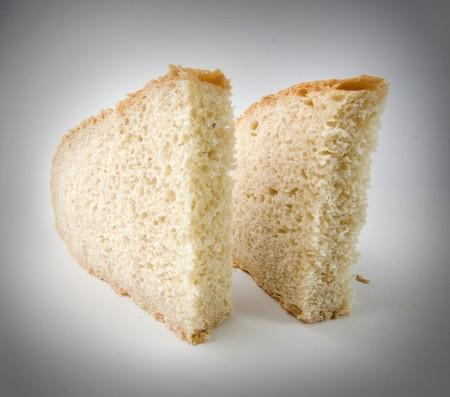 fresh baked bread sliced isolated over white background photo