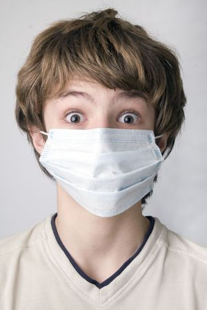 Young boy with the protective mask