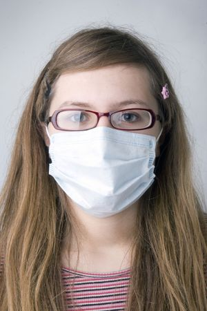 dust mask: Young girl with the protective mask
