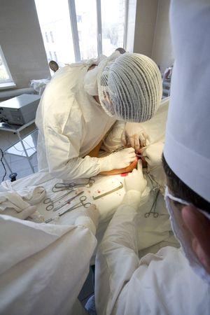 Surgeons team at work photo