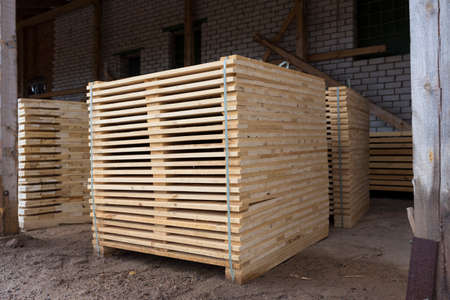 Detail of wooden planks. Wooden pallets. Wood. Lumber. A stack of new wooden planks in the lumber industry. Stock Photo