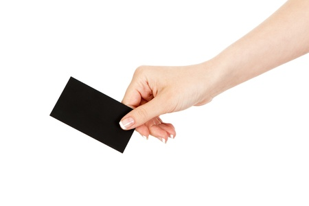 gives: womans hand holding a business card