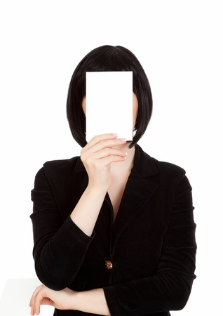 woman covers her face with a cardboard card photo