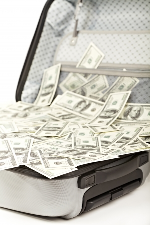 lot of money in a opened suitcase isolated on white Stock Photo - 14530546